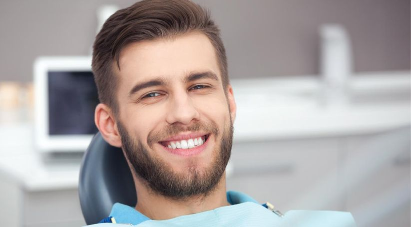 Smiling man on dentist's chair